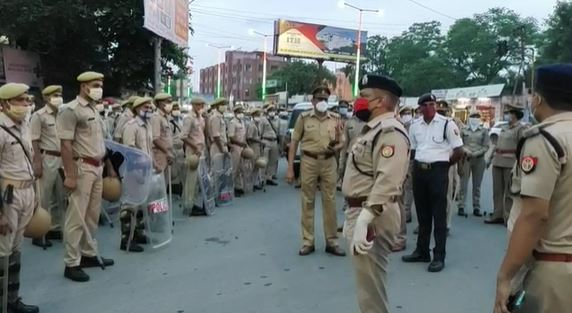 Jhansi police flag march Eye on drone cameras, police flag march
