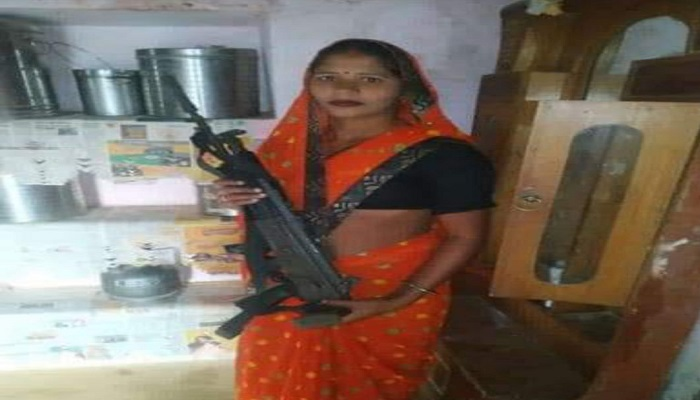 woman in the hands of AK-47
